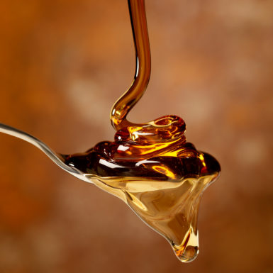 Pouring Maple Syrup over a Spoon -Photographed on Hasselblad H3-22mb Camera